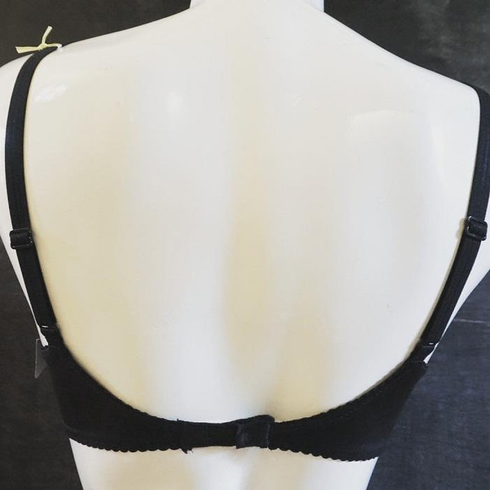 A deep plunge bra by Prima Donna. A satin black finish makes this contemporary bra ideal for the firmer breast. Style 0161334.