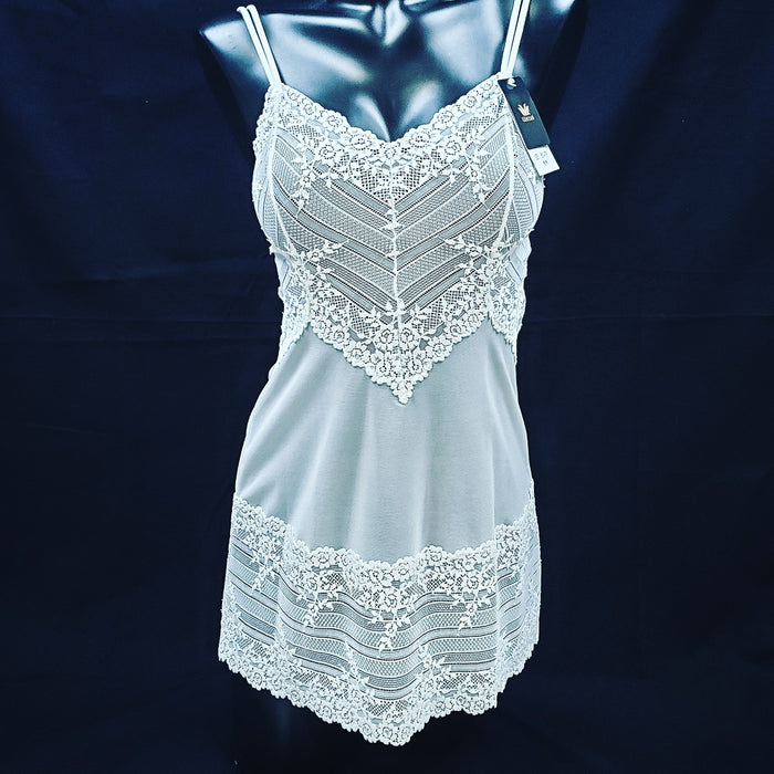 A great Wacoal chemise, Lace Embrace, is soft and versatile. Use her for bed, layering or just hanging around. Mesh body with lace trim. Color white. Style 814191.