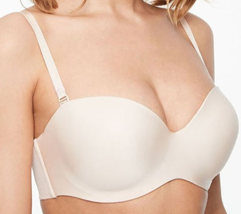 A premium Chantelle strapless bra, Absolute, is smooth and sleek. A tshirt bra with light foam padding. Wear the straps halter, criss cross, traditional, or strapless. Color beige. Style 2925.