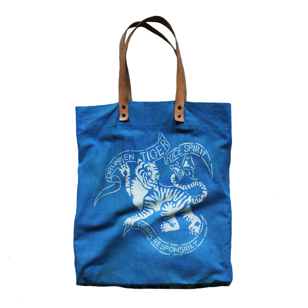 DRUNKEN TIGER indigo dyed tote bag with leather handles. MADE TO ORDER