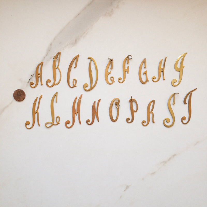 Script initial charms in gold