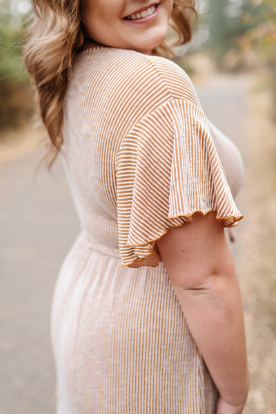 We Call That A Wrap Striped Dress In Rust