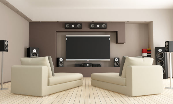 Home Theater with Surround Sound and White Couches