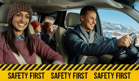 Family In car with safety first caution tape