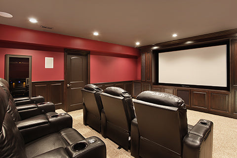 Home Theater with red walls and leather recliners