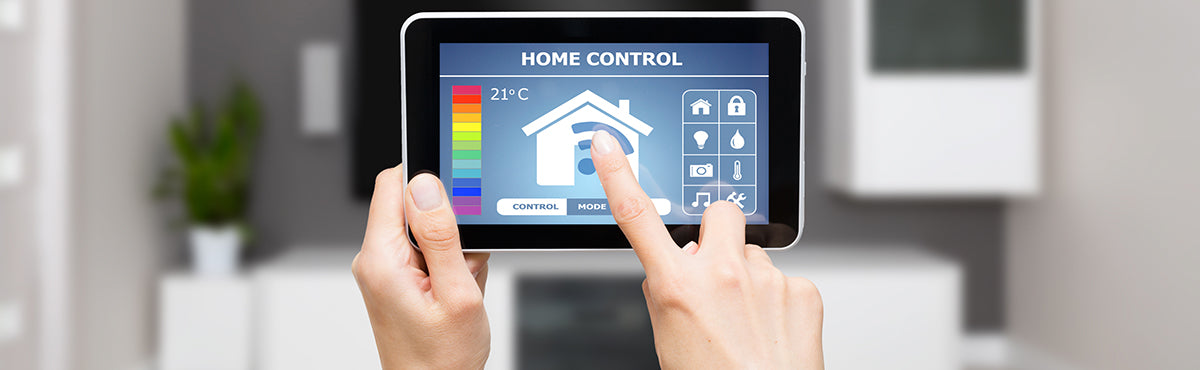 Person controlling home system with tablet