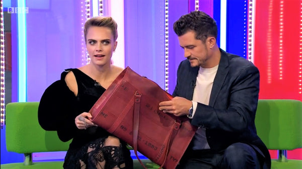 Cara Delevingne and Orlando Bloom with Fire-hose Bag - Elvis & Kresse