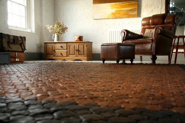 Custom hand woven leather rug by Elvis & Kresse