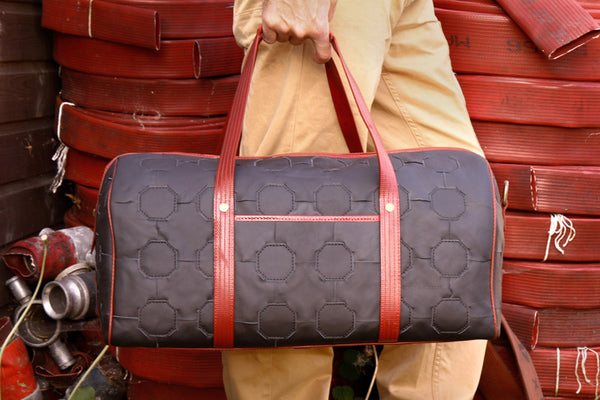 Elvis carries the Elvis & Kresse Duffel bag from the Fire & Hide collection