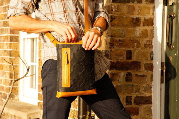 Elvis & Kresse Reporter Bag, made from reclaimed Burberry leather and decommissioned fire-hose