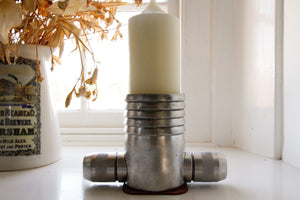 candlestick holders made from vintage fire-hose couplings