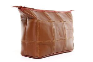 Sustainable cosmetics bag made from reclaimed materials
