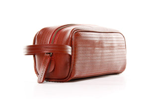 Travel Case by Elvis & Kresse made from decommissioned fire-hose