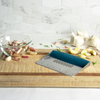 Taste of Home Bench Scraper with Sea Green handle, angled view on cutting board, lifestyle background
