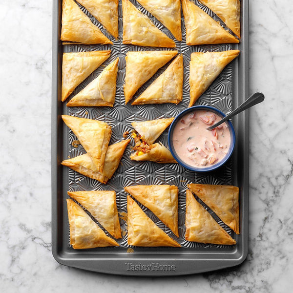 Pizza pockets on baking sheet
