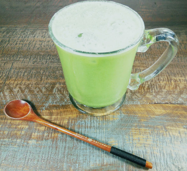 Iced matcha latte with eco friendly bamboo spoon