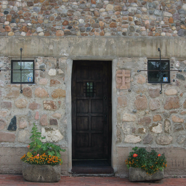 stone house and carved door
