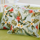 blue palm barkcloth pillow ivory back on green chaise