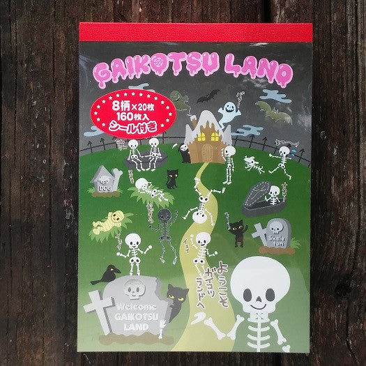 CX66597-Crux Welcome To Gaikostu Land Large Memo Pad with Bonus Sticker Sheet-Skeleton Land