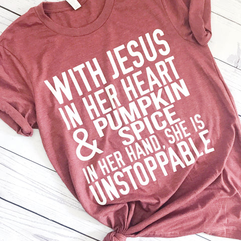 "This is a super soft rust unisex crew neck t-shirt with our ""With Jesus in her heart and pumpkin spice in her hand she is unstoppable"" design. www.karlastorey.com"