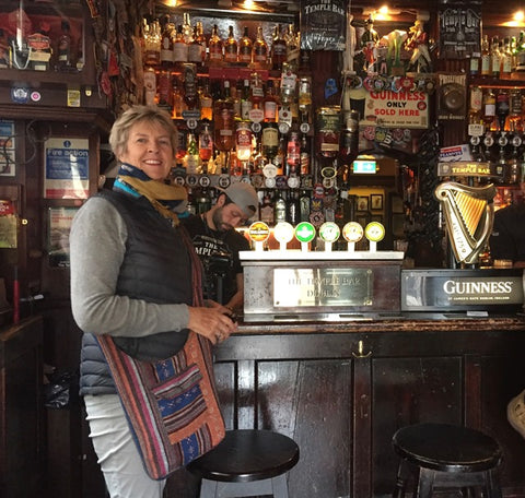 Tourist enjoying Dublin's famous Temple Bar, wearing down jacket from wildkiwiclothing.co.nz