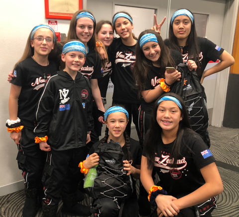 Spoken hip hop dance team with Wild Kiwi bandanas and backpacks