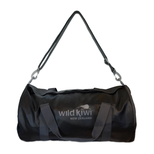 Black packable active bag with shoulder straps and zipped pockets. wildkiwiclothing.co.nz.