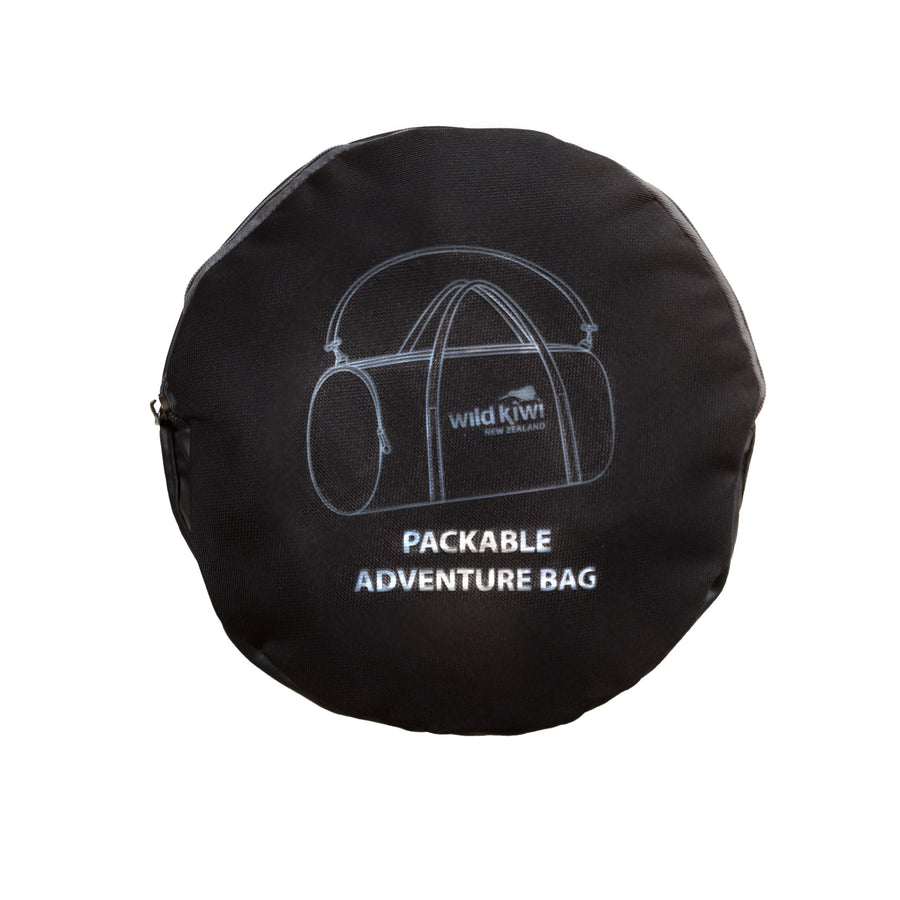 Black packable active bag packed view. Travel accessory. wildkiwiclothing.co.nz.