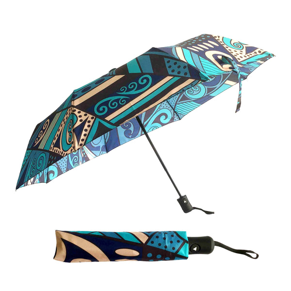 Foldable travel umbrella. New Zealand koru design. www.wild-kiwi.co.nz