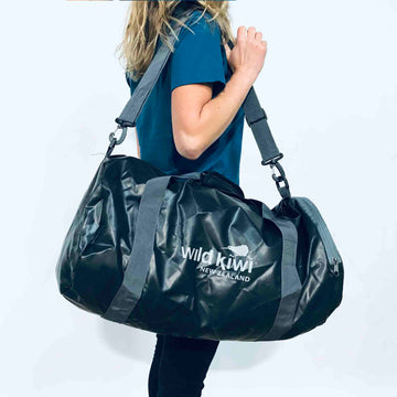 Black packable active bag with shoulder straps and zipped pockets. www.wild-kiwi.co.nz
