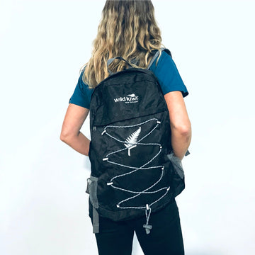 Black backpack, packable, lightweight day pack, fold away pack. Water resistant.