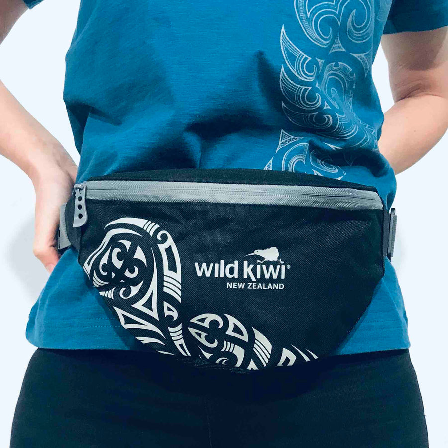 Black waist bag, bum bag, travel bag - New Zealand tattoo design.