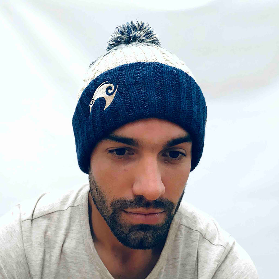 Navy reversible beanie with New Zealand kiwi embroidery and removable pom pom. www.wild-kiwi.co.nz