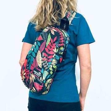 Crossbody backpack with all-over ferns print. Concealed side pocket and adjustable straps. www.wild-kiwi.co.nz