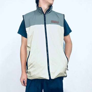 Men's reversible vest. Beige and grey outer layer and black fleece reverse side.