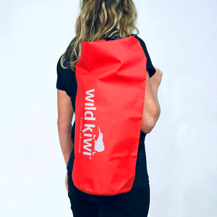 Red 10L Drybag. Waterproof, lightweight. With shoulder strap www.wild-kiwi.co.nz