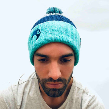 Turquoise reversible beanie with New Zealand kiwi embroidery and removable pom pom. www.wild-kiwi.co.nz