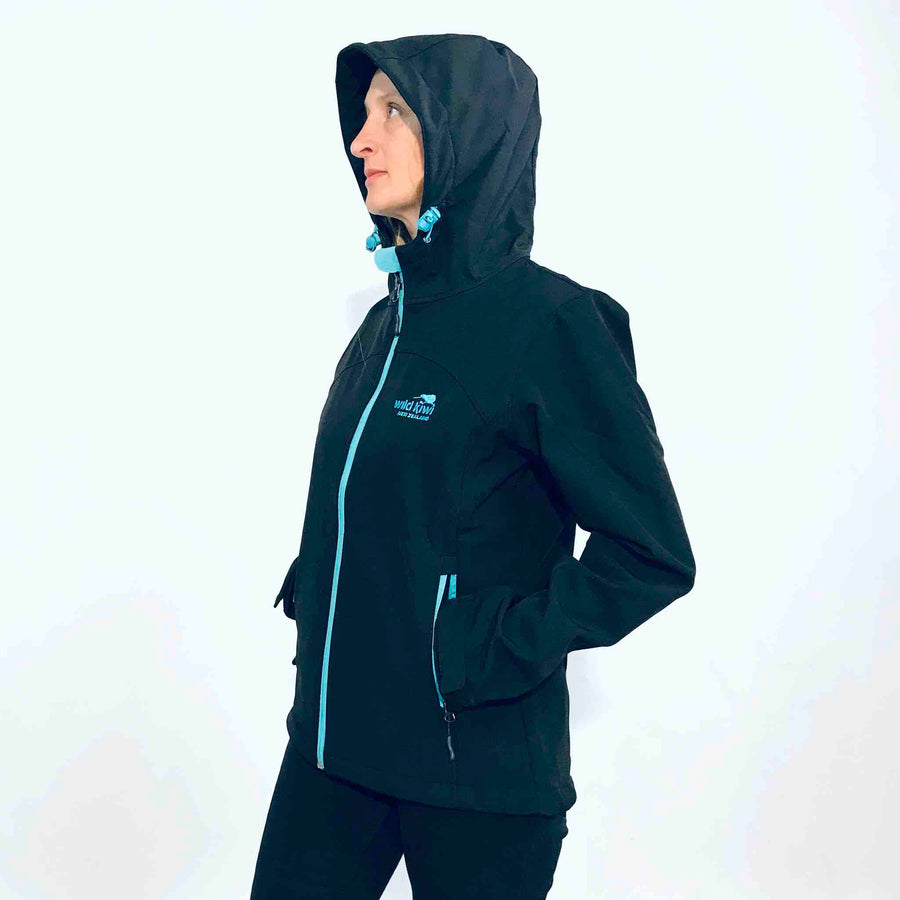 Women's black hooded soft shell jacket with blue lining. Water resistant fabric. www.wild-kiwi.co.nz