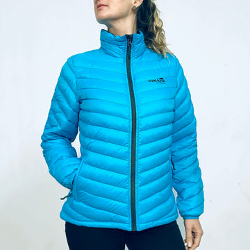 Women's blue down jacket with dark grey lining. Zip closure front and pockets. Best travel jacket, packs away into small bag. www.wild-kiwi.co.nz