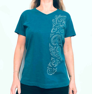 Women's blue v-neck printed New Zealand t-shirt. Features Maori Kowhaiwhai design on side of shirt. www.wild-kiwi.co.nz
