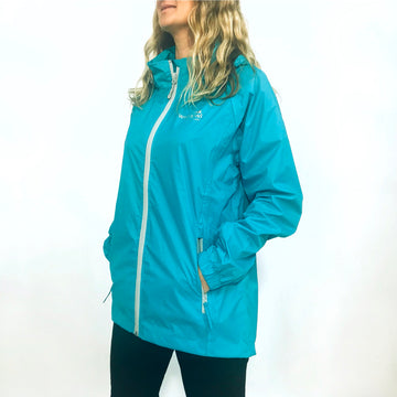 Women's turquoise blue packable raincoat. Wild Kiwi Clothing. New Zealand. www.wild-kiwi.co.nz
