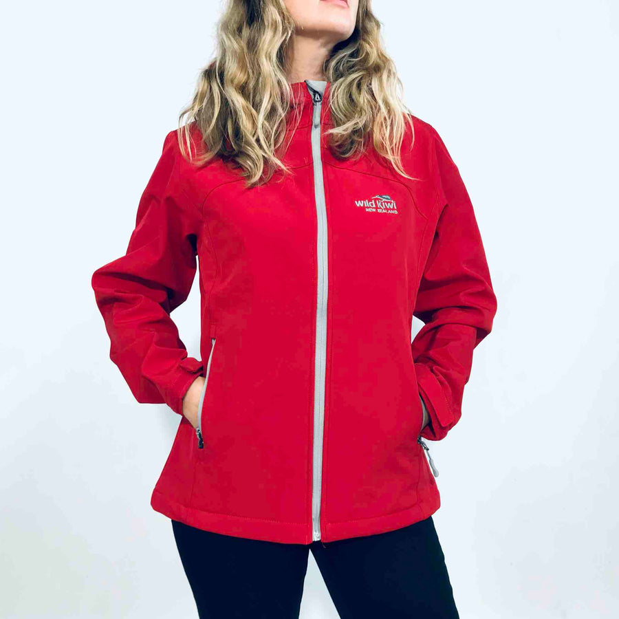 Women's red hooded soft shell jacket with grey lining. Water resistant fabric. www.wild-kiwi.co.nz