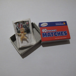 baby card in matchbox with foreign person