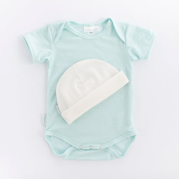 100% Merino wool bodysuit and beanie made in New Zealand, perfect neutral newborn gift. Wanaka