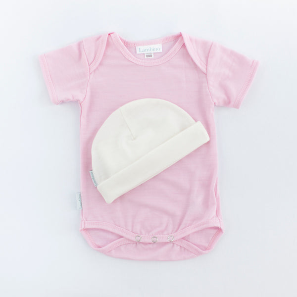 Merino bodysuit and beanie made in New Zealand, perfect newborn gift for a baby girl.