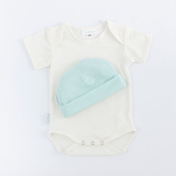 Merino bodysuit and beanie made in New Zealand, perfect neutral newborn gift.