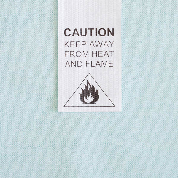 New Merino fire safety baby clothing label, caution