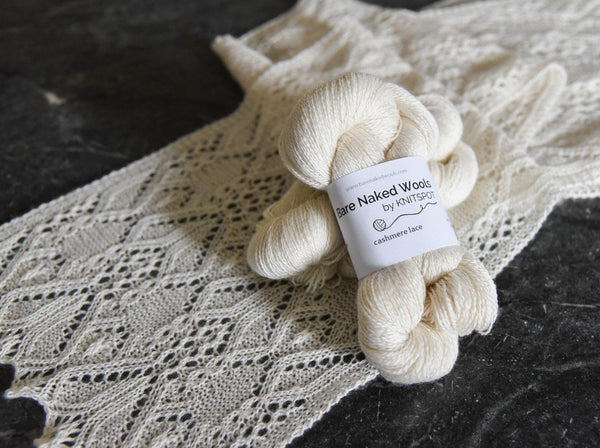 Undyed Cashmere Lace Weight Yarn  placed on whitethistle knit scarf