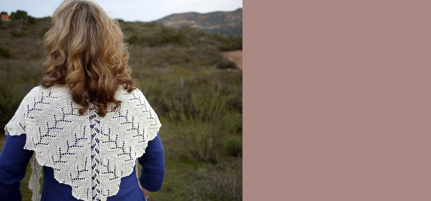 woman from back wearing white lace knitted shawl