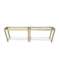 1970S GUY LEFEVRE STYLE GILT METAL CONSOLES WITH TWO GLASS SHELVES